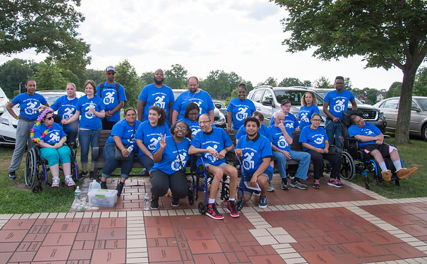 07/24/19 Wesley Bunnell | Staff Members of CRI, Community Residence Inc pose for a group photo before the Walk and Roll on Wednesday afternoon at Walnut Hill Park. The Walk and Roll is hosted by the citys Commission on Persons with Disabilities and celebrates the signing of the American with Disabilities Act of 1990 and serves to raise awareness for improving the quality of life for all residents in the city, regardless of disability.