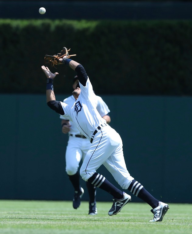 . Detroit Tigers shortstop Dixon Machado catches the ball hit by Cleveland Indians\' Francisco Lindor during the fifth inning of a baseball game, Wednesday, May 16, 2018, in Detroit. (AP Photo/Carlos Osorio)