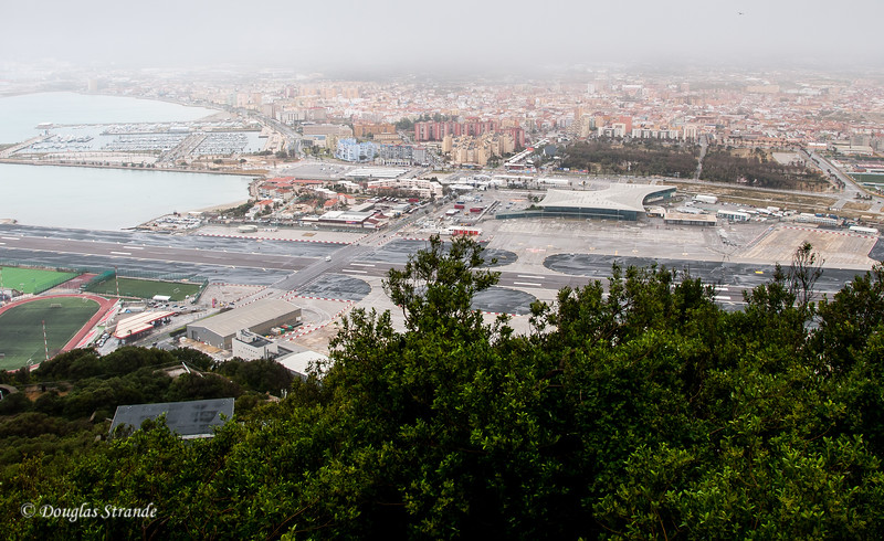 Gibraltar - View of the E/W runway, the N/S road, the border and Spain in the distance