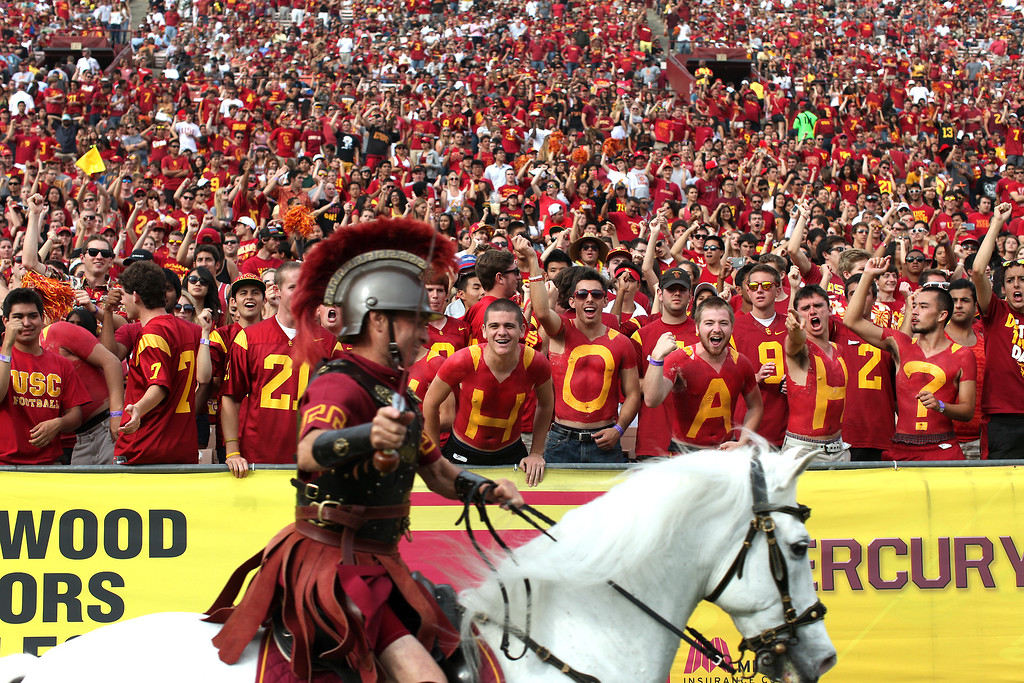 . Traveller runs the sideline by USC students, Saturday, October 26, 2013, at the L.A. Memorial Coliseum. (Michael Owen Baker/L.A. Daily News)