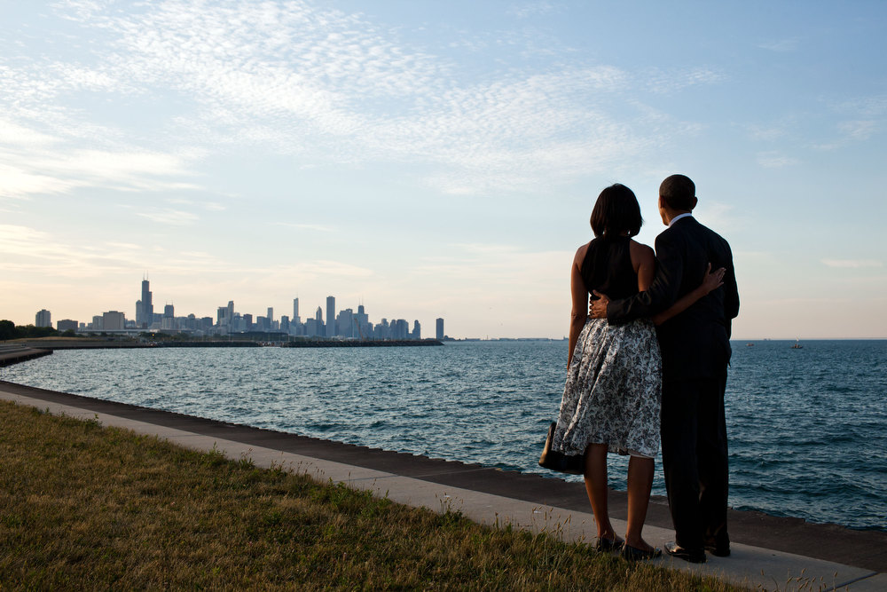 ". June 15, 2012 ""We had just arrived at the helicopter landing zone in Chicago and instead of walking right to the motorcade, the President and First Lady walked past their vehicle to the edge of Lake Michigan to view the skyline of their home town.\""  (Official White House Photo by Pete Souza)"