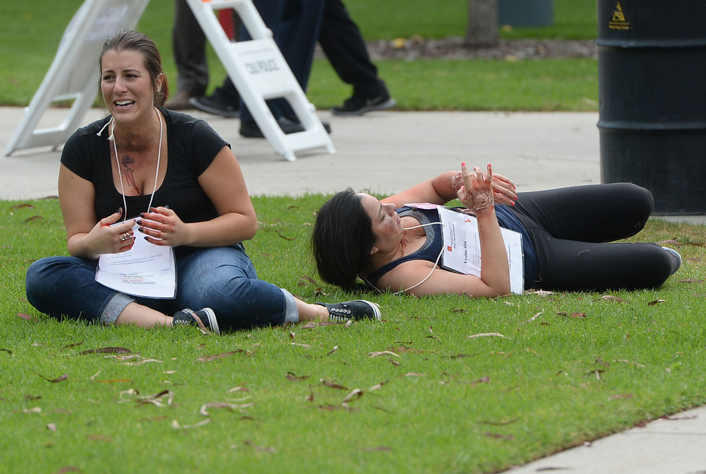 . A multi-agency response exercise to an active shooter and mass casualty incident was held Tuesday on the Cal State Long Beach campus.  Victims scream for help as they make the scenario seem more realistic for first responders. 20130813 Photo by Steve McCrank / Staff Photographer