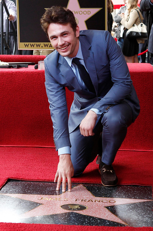 . Actor James Franco poses with his newly unveiled star on the Hollywood Walk of Fame, in Hollywood March 7, 2013. REUTERS/Fred Prouser