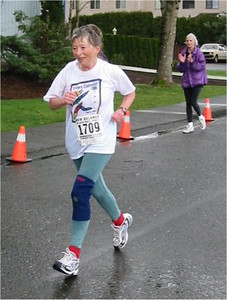 2003 Comox Valley Half Marathon - Jytte Haagensen cheered on by Sandy Anderson