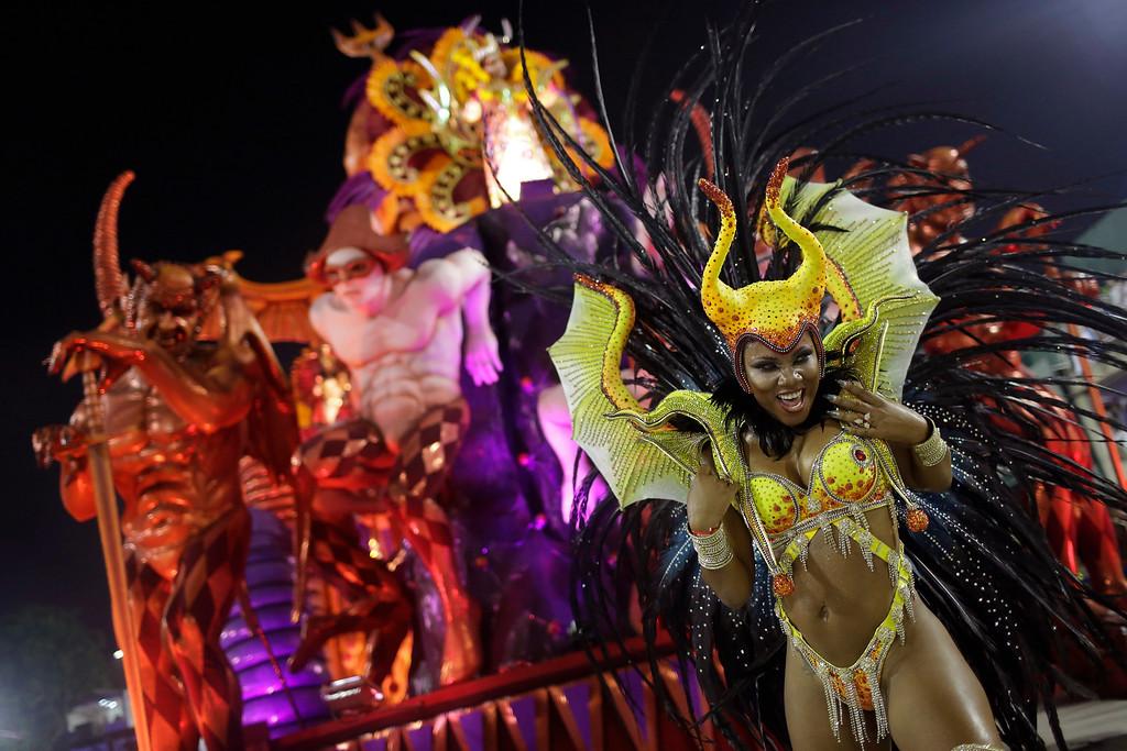 . A performer from the Salgueiro samba school parades during Carnival celebrations at the Sambadrome in Rio de Janeiro, Brazil, Monday, Feb. 27, 2017. (AP Photo/Leo Correa)