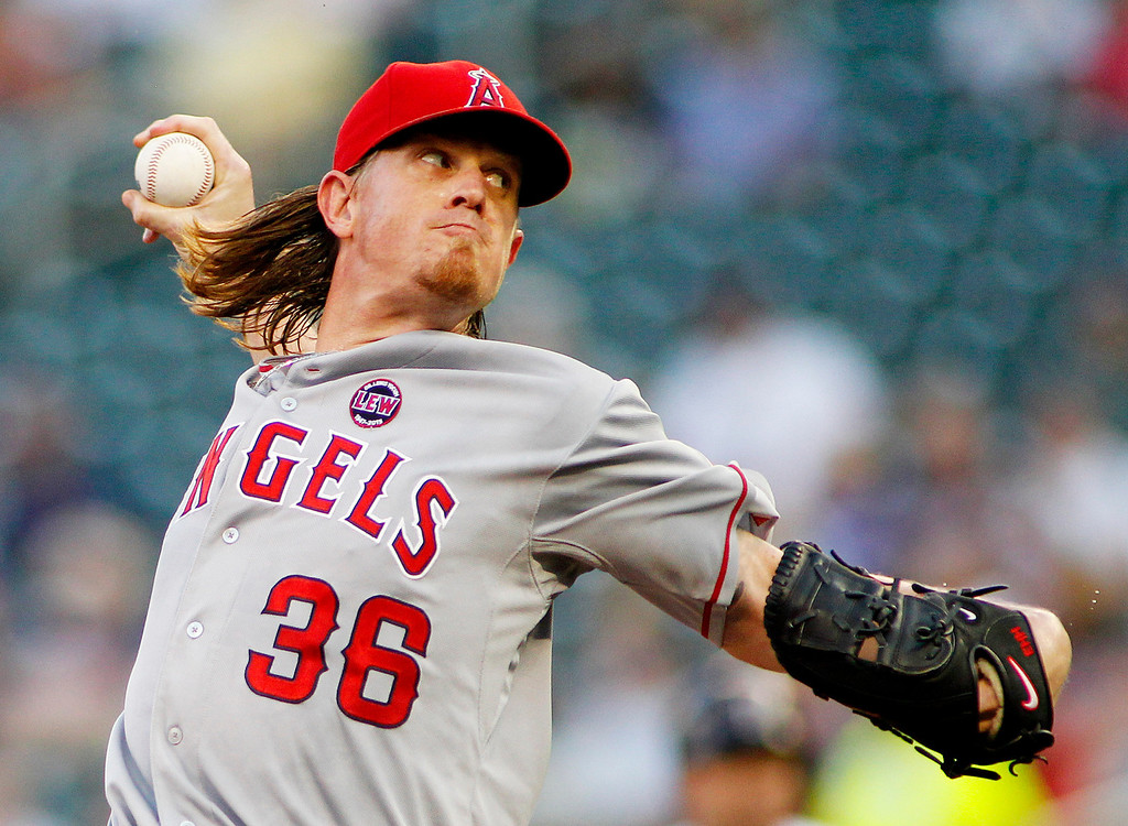 . Los Angeles Angels starting pitcher Jared Weaver  throws to the Minnesota Twins in the first inning of their baseball game in Minneapolis Monday, Sept. 9, 2013.(AP Photo/Andy Clayton-King)