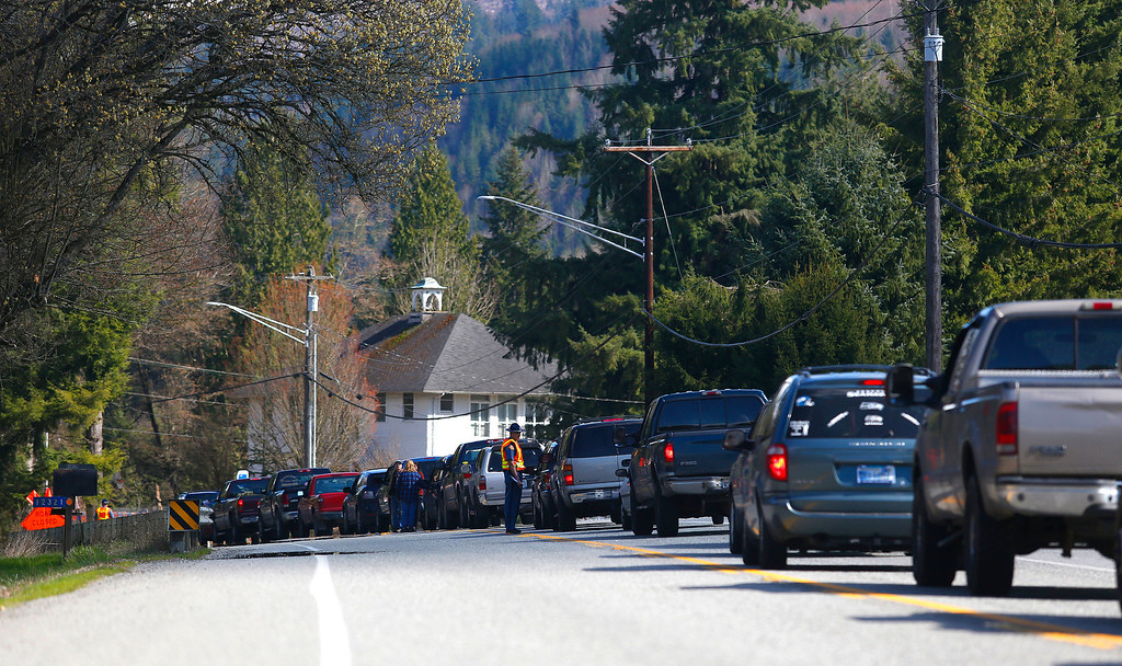 . The Washington State Patrol holds back traffic on eastbound Highway 530 near Trafton, Wash. Sunday, March, 23, 2014, when news that water had started coming through the mudslide blocking the Stillaguamish River.  (AP Photo /The Herald, Mark Mulligan)