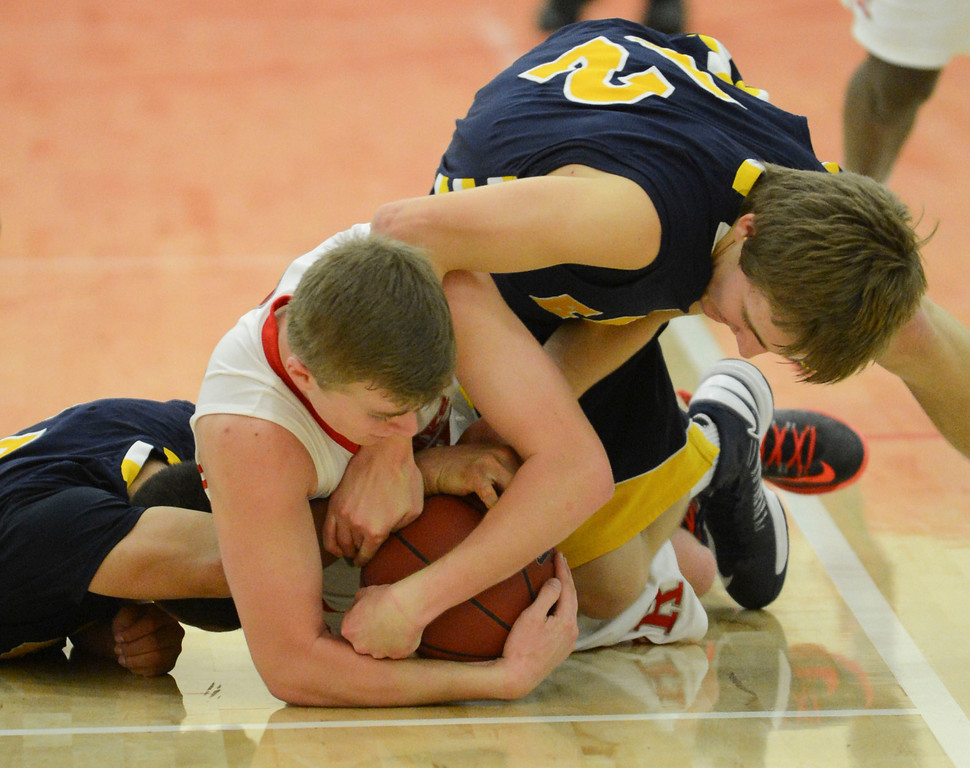 . Arroyo Grande\'s Carson Wack (12) and Matt Willkomm (15) battle Redondo Union\'s Derek Biale (23) on the floor for the ball in a CIF Southern Section Division II-A semifinal boys basketball game Tuesday night in Redondo Beach.  Redondo won the game 55-41 and advances to the title game. 20130226 Photo by Steve McCrank / Daily Breeze