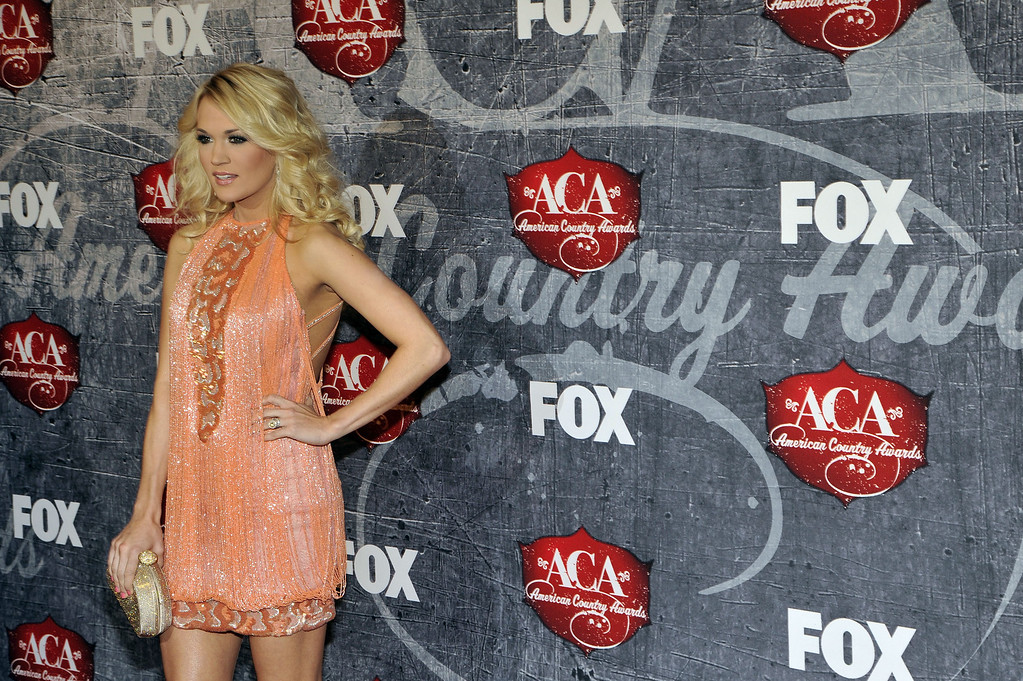 . Singer and songwriter Carrie Underwood arrives at the American Country Awards on Monday, Dec. 10, 2012, in Las Vegas. (Photo by Jeff Bottari/Invision/AP)