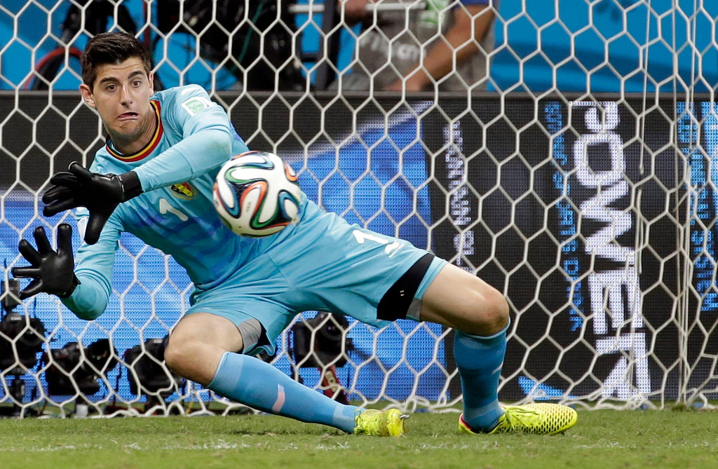 . Belgium\'s goalkeeper Thibaut Courtois blocks a shot during the World Cup round of 16 soccer match between Belgium and the USA at the Arena Fonte Nova in Salvador, Brazil, Tuesday, July 1, 2014. (AP Photo/Felipe Dana)