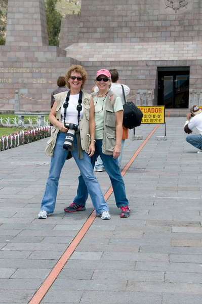 """Barbra and Debbi at the Mitad del Mundo """"Middle of the world"""" Monument"""