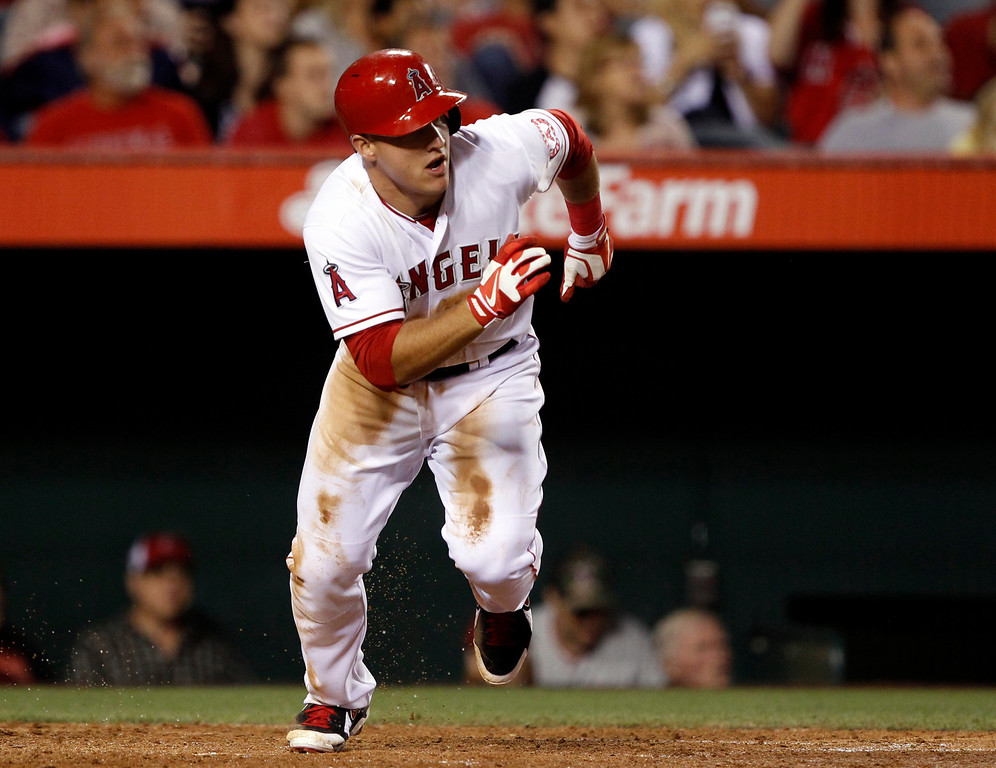 . Los Angeles Angels\' Mike Trout races from home, as he hits a triple against the Seattle Mariners in the fourth inning during a baseball game Tuesday, May 21, 2013 in Anaheim.    (AP Photo/Alex Gallardo)