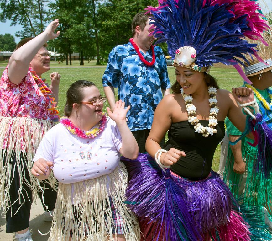 . Duncan Scott/DScott@News-Herald.com Jocelyn Pierce dances with Leilani Bowersock of OHana Aloha during a luau on June 18 at the Lake County Board of Developmental Disabilities/Deepwood Vocational Guidance Center.