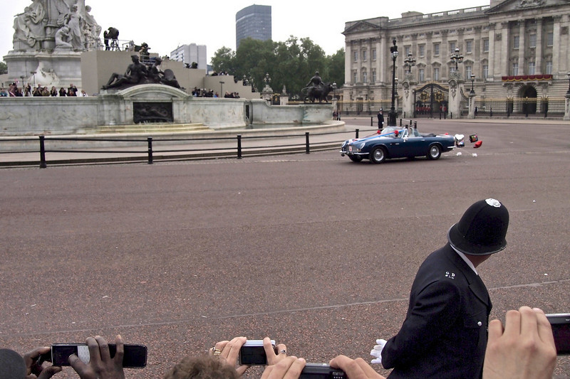 Royal Wedding – William and Kate in Aston Martin Volante.  The PC steals a glance.