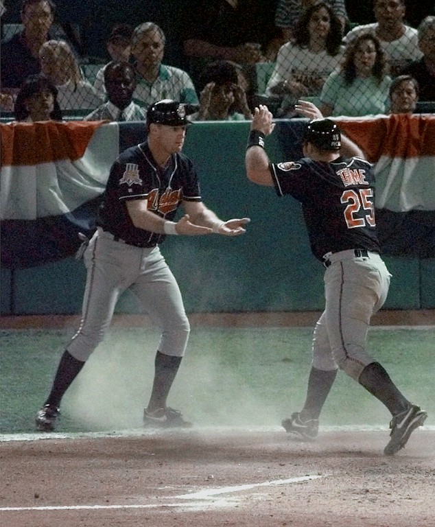 . Cleveland Indians Matt Williams, left, and Jim Thome  (25) celebrate after they both scored on a hit by pitcher Chad Ogea in the second inning of Game Six of the World Series, Saturday, Oct. 25, 1997, at Pro Player Stadium in Miami. (AP Photo/Pat Sullivan)