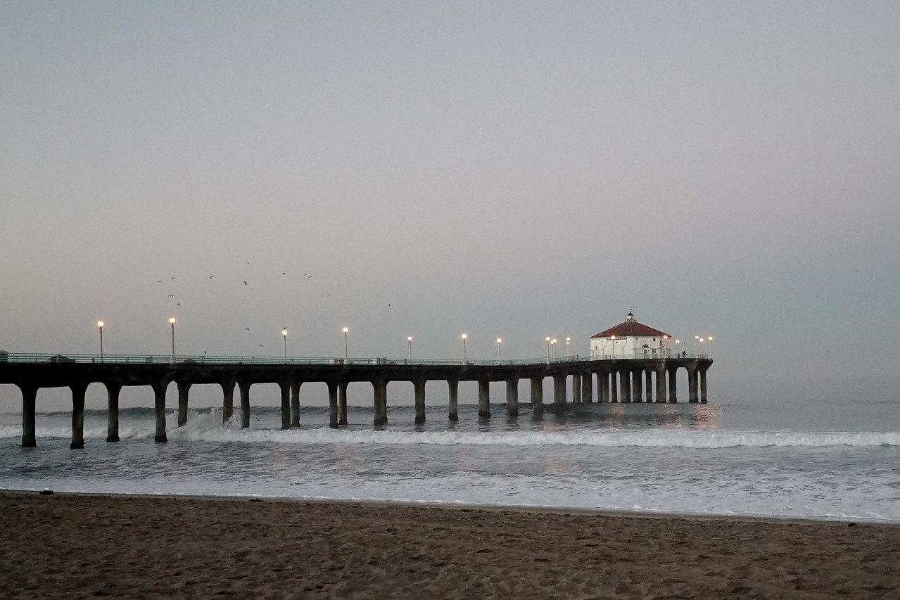 The Manhattan Beach Pier, shot from the Pier, with the morning lights still lit