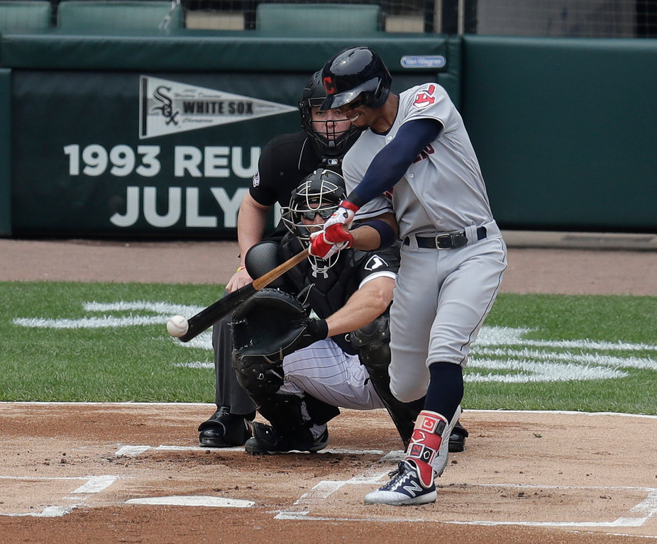 . THIS CORRECTS TO HOME RUN, NOT GRAND SLAM, AND FRANCISCO LINDOR, NOT SANDY ALOMAR JR. - Cleveland Indians\' Francisco Lindor hits a home run off Chicago White Sox pitcher Carlos Rodon during the first inning of baseball game Thursday, June 14, 2018, in Chicago . (AP Photo/Annie Rice)