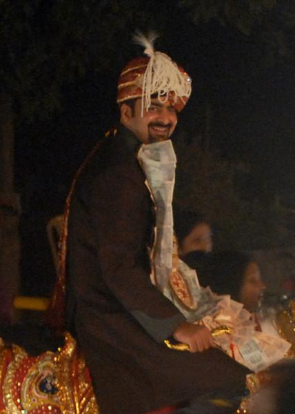 groom on horse smiling.jpg