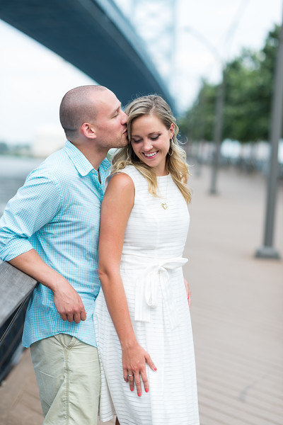 This was at the Ben Franklin Bridge in Philly /////// .  Our latest engagement shoot took us to the city of brotherly love, the one and only Philadelphia! We were so thrilled to be able to shoot in a city for an even cooler couple.   Devon and Eric showed Emerald Stone the ropes and introduced us to just a few of their favorite spots, including the scenic walking paths near the Ben Franklin Bridge, some quiet, quaint spots beside the Schuylkill River, and the awesome PHS Pop-Up Garden and Biergarten on South Street.  Even better yet, we got to meet Devon and Eric's 8 month old puppy, Bodhi, who is too adorable for words. We're pretty much totally in love with this couple and their home, and it's not hard to see why.
