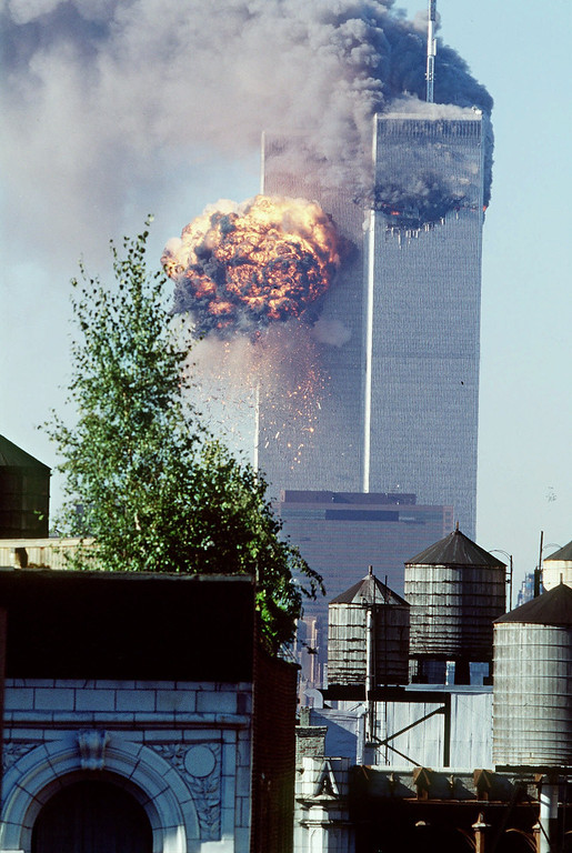 . A fireball erupts from one of the World Trade Center towers as it is struck by the second of two airplanes in New York, Tuesday, Sept. 11, 2001.  (AP Photo/Todd Hollis)