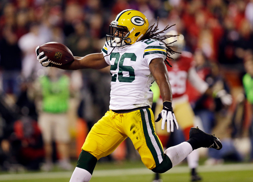 . Green Bay Packers running back DuJuan Harris (26) scores on an 18-yard touchdown run against the San Francisco 49ers during the first quarter of an NFC divisional playoff NFL football game in San Francisco, Saturday, Jan. 12, 2013. (AP Photo/Marcio Jose Sanchez)