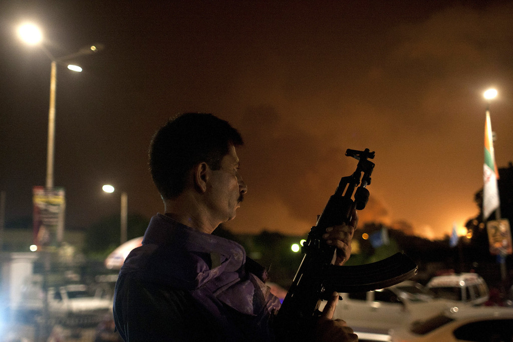 . A Pakistani soldier takes position at Jinnah International Airport  where security forces are fighting with gunmen who disguised themselves as police guards and stormed a terminal used for VIPs and cargo, Sunday night, June 8, 2014, in Pakistan. The airport attack still was ongoing early Monday in Karachi, a sprawling port city on the southern coast of Pakistan, although officials said all the passengers had been evacuated.  (AP Photo/Shakil Adil)