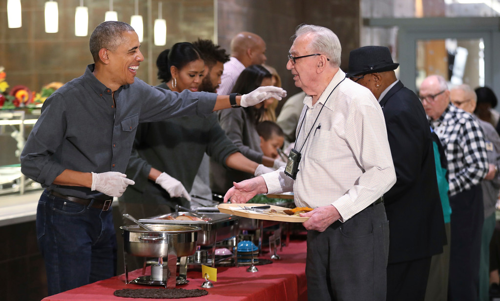 . President Barack Obama with first lady Michelle Obama and some relatives serve Thanksgiving meals to residents of the Armed Forces Retirement Home, in Washington, Wednesday, Nov. 23, 2016. (AP Photo/Manuel Balce Ceneta)