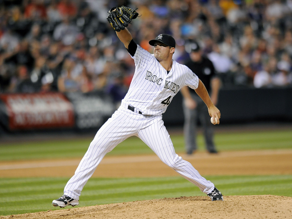 . Colorado Rockies relief pitcher Rex Brothers throws in the seventh inning of a baseball game against the Washington Nationals on Tuesday, July 22, 2014, in Denver. (AP Photo/Chris Schneider)