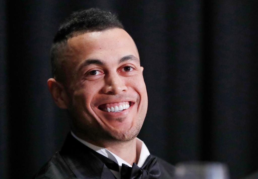 . National League Most Valuable Player Giancarlo Stanton. formerly a Miami Marlin, smiles as his listens to speakers during the New York Chapter of the Baseball Writers\' Association of America annual dinner in New York, Sunday, Jan. 28, 2018, where he picked up his award and met new teammate Aaron Judge of the New York Yankees. Stanton signed with the Yankees in the off season. (AP Photo/Kathy Willens)