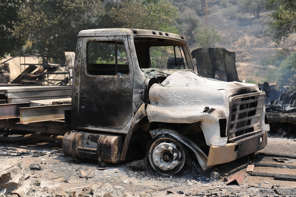 . A burnt truck in the 43400 block of Lake Hughes Road from the Powerhouse Fire, Sunday, June 2, 2013. (Michael Owen Baker/Staff Photographer)