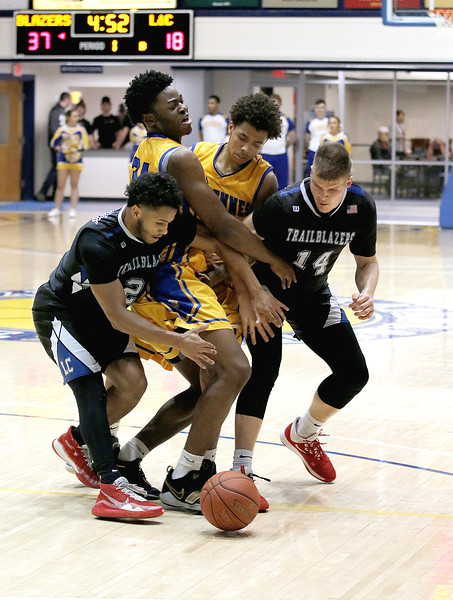 Photo by Matt Griffith/VU  Vincennes University's Chinedu Okanu and Craig Porter, middle, along with Lewis and Clark's Ulysses Delayney, left, and Amandas Urkis, 14, charge after a loose ball Monday night in the P.E. Complex.
