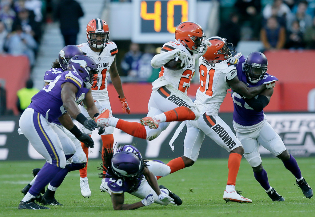. Cleveland Browns running back Duke Johnson Jr. (29) jumps to avoid a tackle during the first half of an NFL football game against Minnesota Vikings at Twickenham Stadium in London, Sunday Oct. 29, 2017. (AP Photo/Tim Ireland)