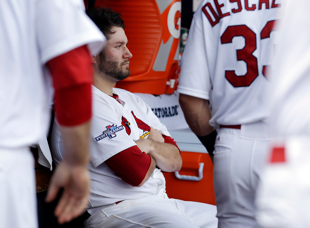 . St. Louis Cardinals pitcher Lance Lynn, center, sits in the dugout after he was relieved in the fifth inning against the Pittsburgh Pirates in Game 2 of baseball\'s National League division series on Friday, Oct. 4, 2013, in St. Louis. (AP Photo/Jeff Roberson)