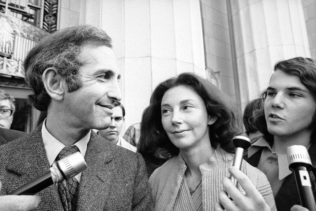 . In this Wednesday, April 12, 1973 photo, Daniel Ellsberg, co-defendant in the Pentagon Papers trial, talks with newsmen after he testified in Los Angeles. Next to him is his wife, Patricia. Ellsberg, who vividly described his journey to disillusionment in Vietnam on Wednesday, will climax that story on Thursday, telling jurors how he risked his government career to copy the Pentagon Papers, hoping to end the war. As the last U.S. combat troops left Vietnam 40 years ago, angry protesters still awaited them at home. North Vietnamese soldiers took heart from their foes\' departure, and South Vietnamese who had helped the Americans feared for the future. While the fall of Saigon two years later � with its indelible images of frantic helicopter evacuations � is remembered as the final day of the Vietnam War, Friday marks an anniversary that holds greater meaning for many who fought, protested or otherwise lived it.  (AP Photo)