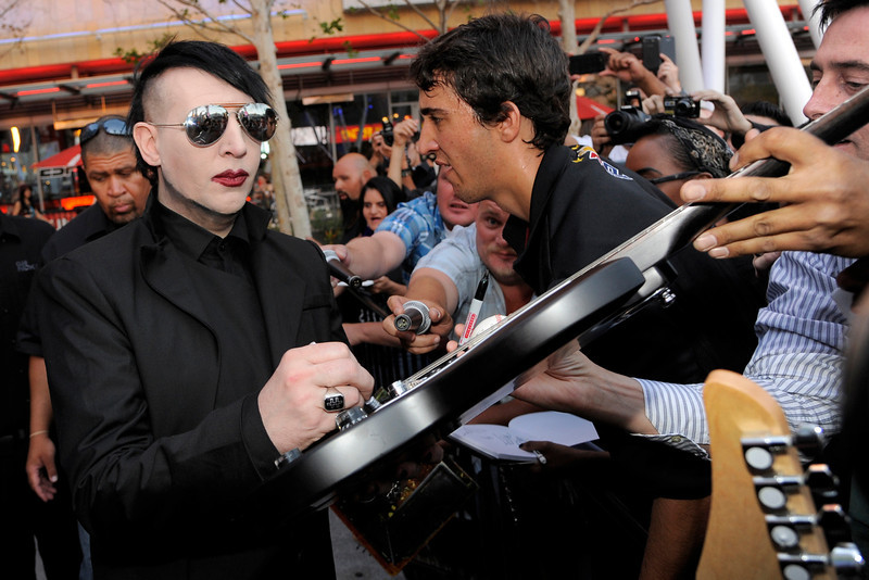 . Marilyn Manson signs a guitar for a fan before the 2013 Revolver Golden Gods Award Show at Club Nokia on Thursday, May 2, 2013 in Los Angeles. (Photo by Chris Pizzello/Invision/AP)