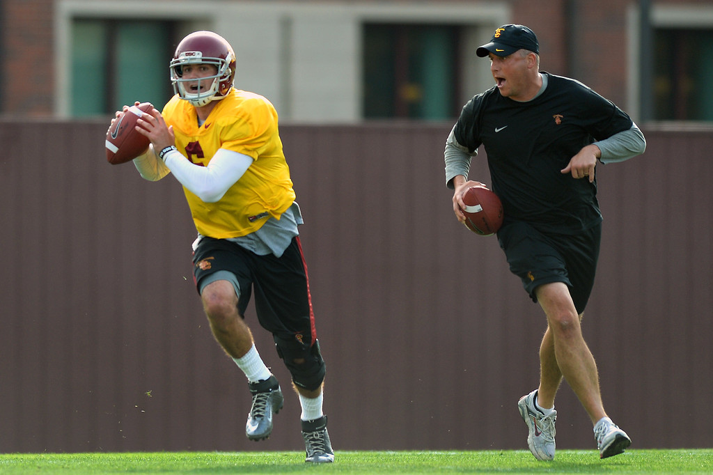 . USC QB Cody Kessler rolls out with quarterbacks coach Clay Helton during practice, Tuesday, March 25, 2014, at USC. (Photo by Michael Owen Baker/L.A. Daily News)