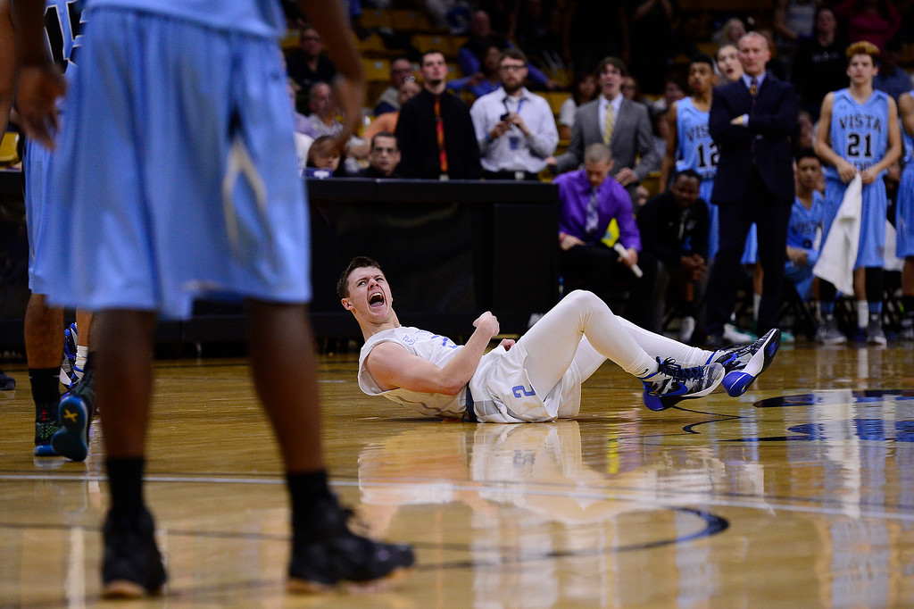 . Mitchell Mayber (2) of Pueblo West screams after hitting the floor during the third quarter at the Coors Events Center on March 11, 2016 in Boulder, Colorado. Pueblo West defeated Vista Ridge 65-54 to advance to the 4A finals of Colorado state basketball tournament.  (Photo by Brent Lewis/The Denver Post)