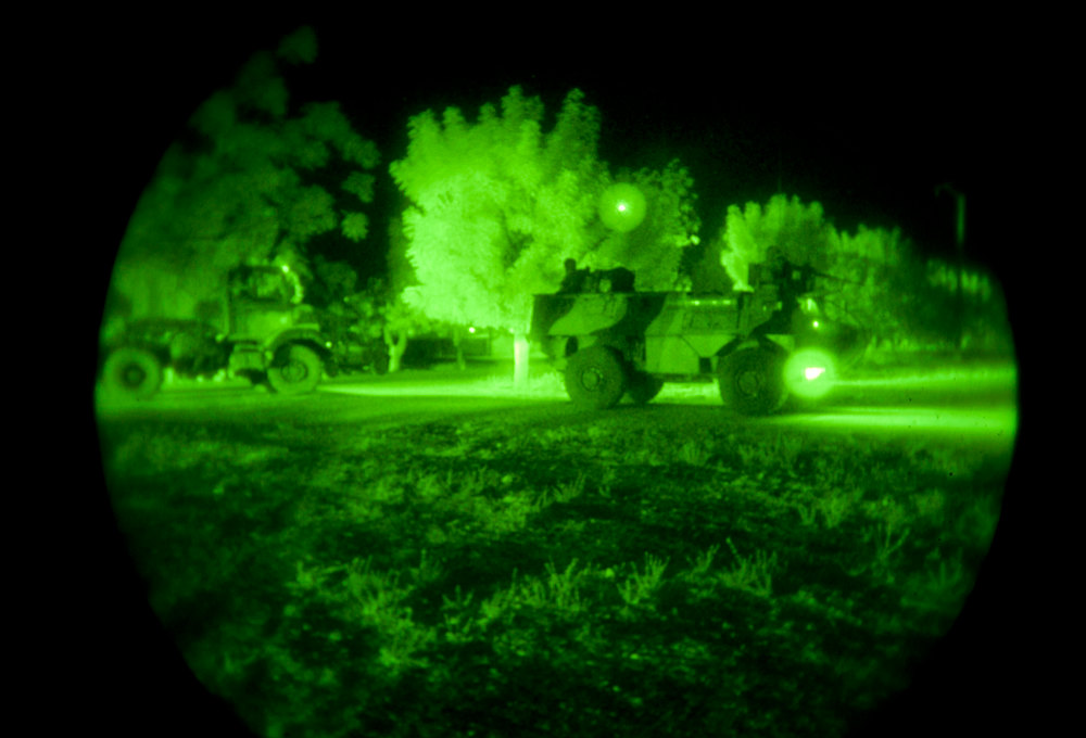 . This night vision photo provided by the ECPAD/French Army shows French military armored vehicles on Bamako airport, Tuesday, Jan.15, 2013.  Islamists in Mali on Wednesday prevented residents from leaving the towns they are holding, and some fear they will be used as human targets by the extremists as French troops pressed forward to launch direct combat within hours. (AP Photo/Jeremy Lempin, ECPAD, EMA)