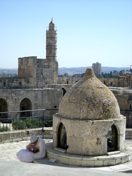mother feeding child at the citadel, old city of Jerrusalem