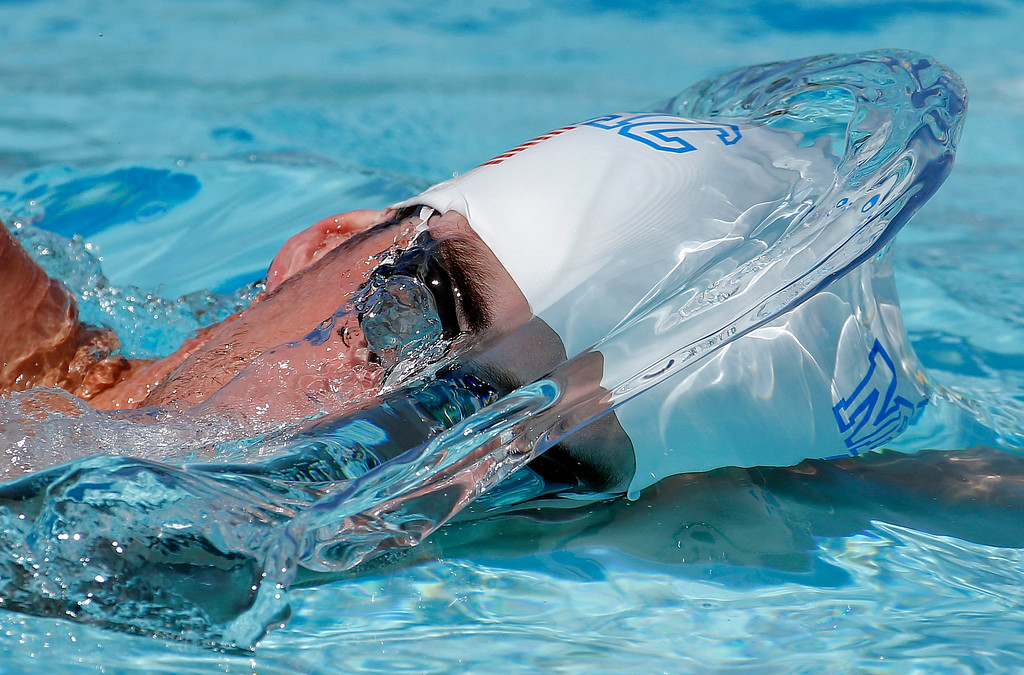 . Michael Phelps warms up prior to a 50-meter freestyle preliminary heat at the Arena Grand Prix swim event, Friday, April 25, 2014, in Mesa, Ariz. It is Phelps\' second competitive event after a nearly two-year retirement. (AP Photo/Matt York, File)