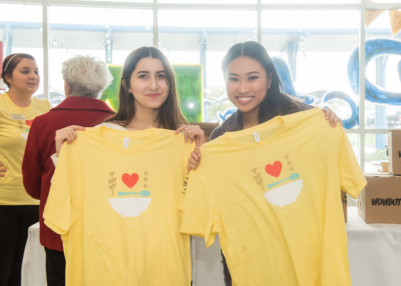 Gina Jifi (left) and Khaira Boac volunteer during the One Million Acts of Good in the UC Rotunda.