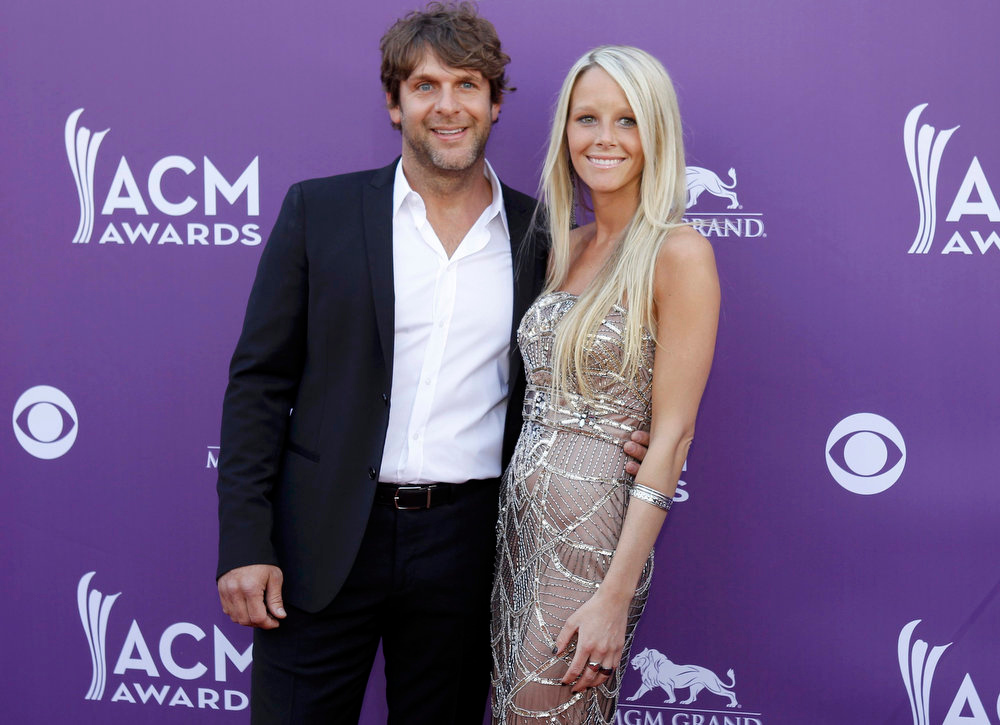 . Singer Billy Currington and his guest arrive at the 48th ACM Awards in Las Vegas April 7, 2013. REUTERS/Steve Marcus