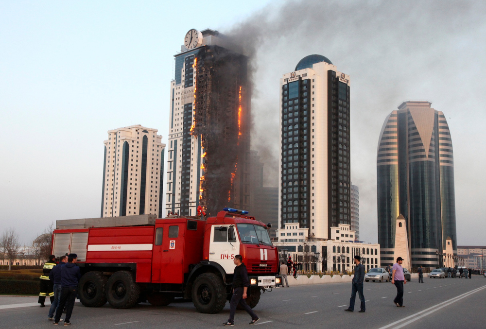 . A multi-story building, which is part of the Grozny-City complex, is seen on fire in the Chechen capital Grozny, April 3, 2013. No casualties were reported.  REUTERS/Yelena Fitkulina