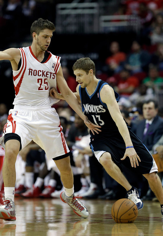 . Houston Rockets\' Chandler Parsons (25) defends against the Minnesota Timberwolves\' Luke Ridnour (13). (AP Photo/Pat Sullivan)