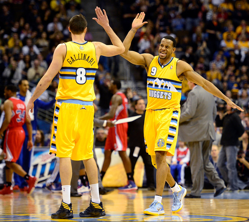 . Denver Nuggets shooting guard Andre Iguodala (9) high fives small forward Danilo Gallinari (8) against the Los Angeles Clippers during the second half of the Nugget\'s 92-78 win at the Pepsi Center on Tuesday, January 1, 2013. AAron Ontiveroz, The Denver Post