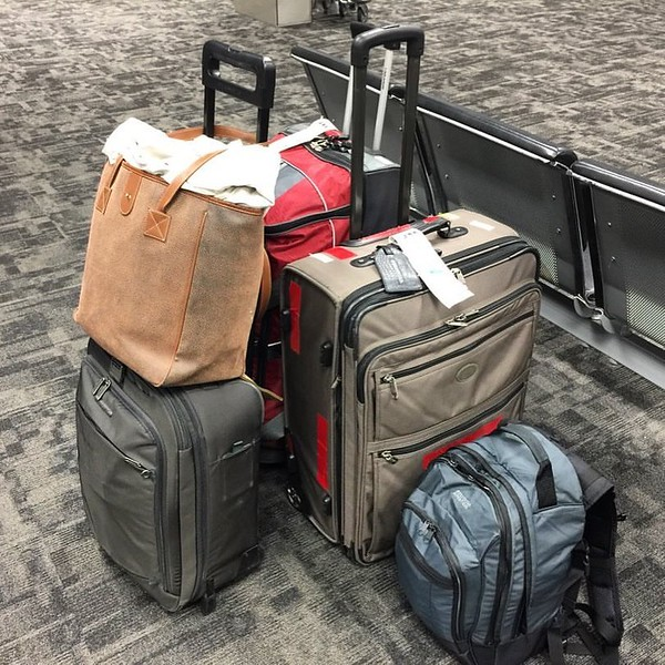 Luggage staged at the airport for a holiday trip