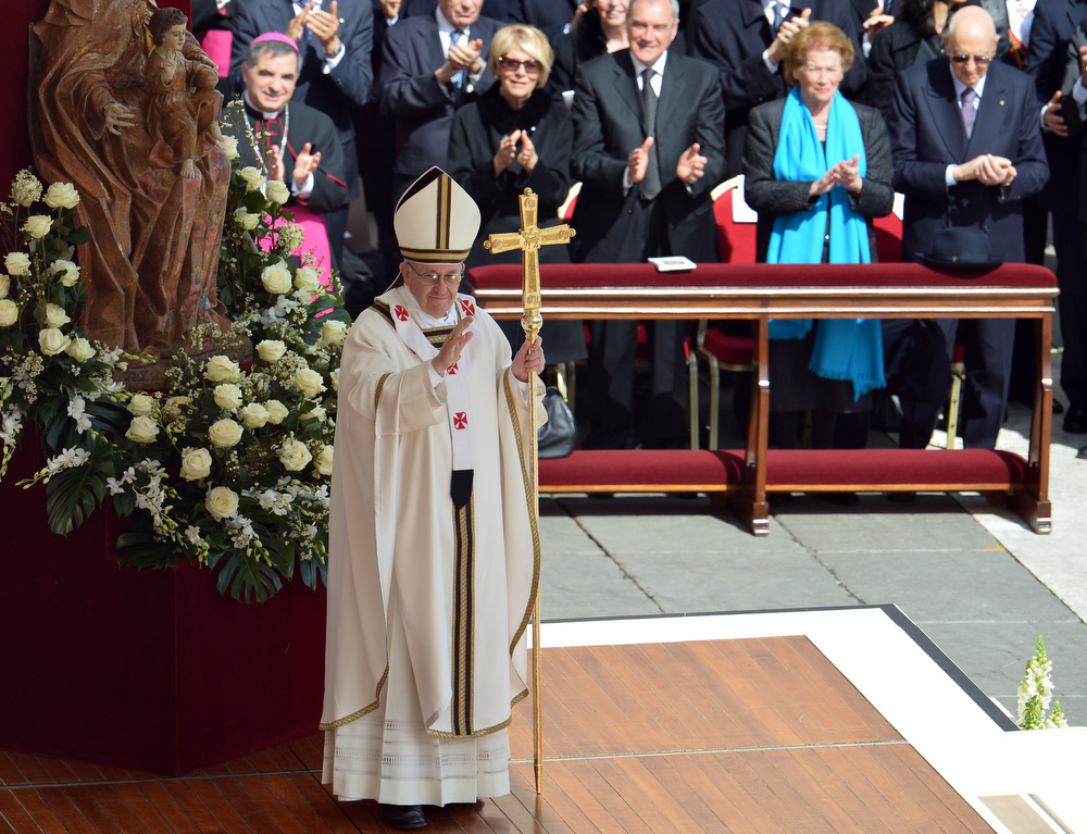 . Pope Francis stands in the front of a statue of Virgin Mary and Christ during his grandiose inauguration mass on March 19, 2013 at St peter\'s square at the Vatican. Pope Francis swept into St Peter\'s Square on Tuesday to greet throngs of pilgrims before a sumptuous ceremony in which Latin America\'s first pontiff will receive the formal symbols of papal power.  ALBERTO PIZZOLI/AFP/Getty Images