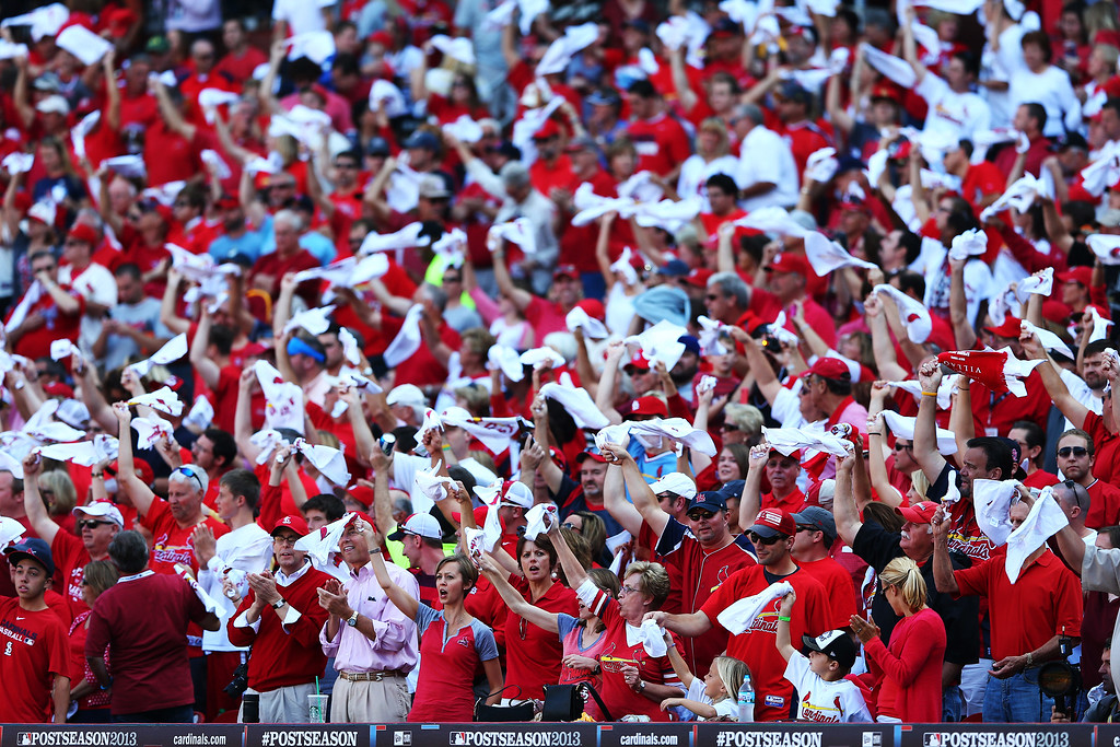 . ST LOUIS, MO - OCTOBER 12:  St. Louis Cardinals fans get ready for Game Two of the National League Championship Series against the Los Angeles Dodgers at Busch Stadium on October 12, 2013 in St Louis, Missouri.  (Photo by Elsa/Getty Images)