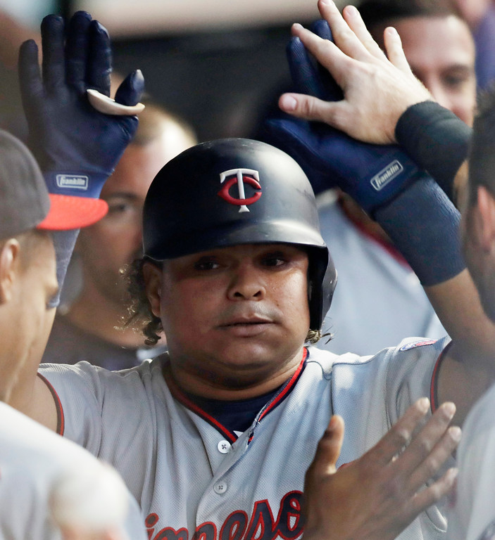 . Minnesota Twins\' Williams Astudillo is congratulated by teammates after hitting a solo home run off Cleveland Indians starting pitcher Adam Plutko during the third inning of a baseball game Wednesday, Aug. 29, 2018, in Cleveland. (AP Photo/Tony Dejak)