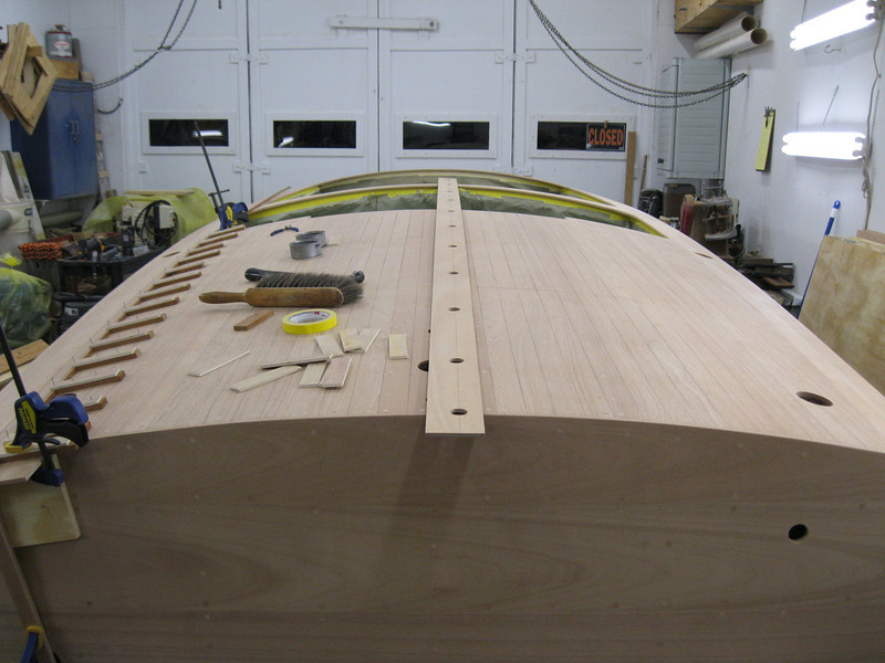 Rear deck with plugs cut deck sanded and deck seam jig in place.